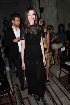 Anne Hathaway at the Valentino Haute Couture Fall/Winter 2011/12 fashion show during Paris Fashion Week July 6, 2011. Couture: Black Laced Dress.