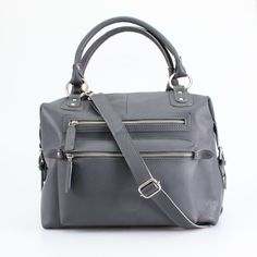 Handcrafted from beautiful thick and supple leather, this gray tote bag is perfect for all seasons. Deceptively large, the two zipped front