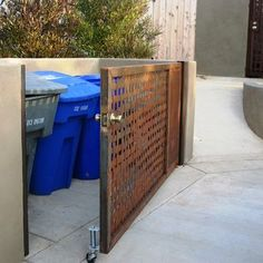 Trash Enclosure Design so can keep cans in one spot for pickup but don't annoy the neighbors with leaving them out in the street.