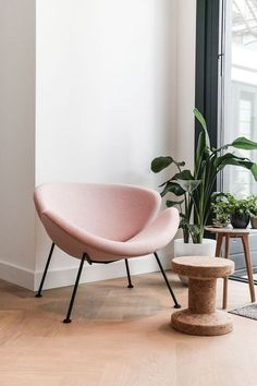 Blush chair and cork stool with plants - perfect combination