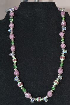 Purple and green beads, green crystal and silver accents