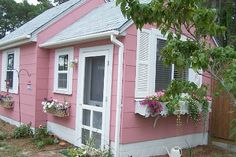 Can't get enough of this cotton candy house and sweet window boxes.