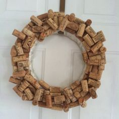 my sister's wine cork wreath - use a styro foam ring and hot glue ribbon around the ring. Hot glue wine corks randomly around the wreath.