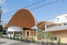 described by takashige yamashita 'like a big tree', this building's curving canopy shelters a space not just for the children, but for the local community.