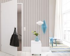 Limitless is a classic wide striped wallpaper with a mix of unique textures. The simplicity and sophistication of this wallpaper will make it a staple in your hallways or foyers. Cool Grey Limitless Wallpaper