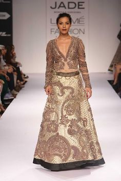 An embroidered creation from designers Monica Shah & Karishma Swali's collection, inspired by the temples of Hoysala (former Southern Indian empire) at Lakme Fashion Week Winter Festive 2014. Read more about Lakme Fashion Week on my blog - http://bigfatasianwedding.com/