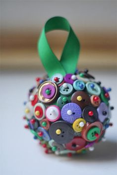 Button Ball Ornament from www.factorydirectcraft.com  Styrofoam ball base, glass head pins, scads of BUTTONS!!!!!
