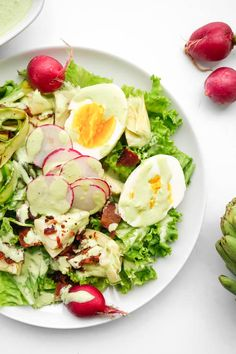 Spring Cobb Salad with Green Goddess Dressing [eggs, radishes, artichoke hearts - canned or fresh, crispy bacon, shaved asparagus, lettuce. Sauce: Greek yoghurt, scallions, terragon, parslley, lime juice, garlic, apple cider vinegar, cayenne, olive oil]