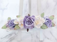 This flower crown is a mix of several kinds of flowers with some greeneries. The main colors are white and lavender with some purple. The dahlias are in white. The roses are in light lavender, lavender, and white. The cherry blossoms and babys breath are in white with lavender tip.  PLEASE NOTE The colors may appear lighter in photos.  >>>>>>>>>>>>>>>>>>>>>>>>>>>>>>>>  MATERIAL: mulberry paper flo...