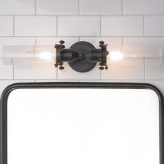 Industrial Bolted Tube Bath Light Classic and industrial style merge in this tube bath light which features traditional finishes coupled with bolt detailing and fashionable yet functional design. Available in Satin Nickel and Oil Rubbed Bronze. 2x60 watt max medium base sockets.