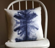 rorschach-esque water-color pillow-- how dreamy.