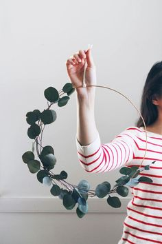 Modern Eucalyptus Wreath DIY craft kit to make your own 12 modern wreath or order the finished wreath made for you. Your choice of brass or copper wire, paired with preserved eucalyptus branches. Branches can go only on the bottom with top metal exposed or set skewed to one side for an