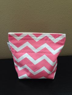 The exterior features a coral/pink and white chevron print. It is fully lined with a coordinating natural unbleached cotton fabric on the