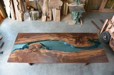 Yes, please. Gorgeous walnut dining table.  See this craftsperson/artist's site.