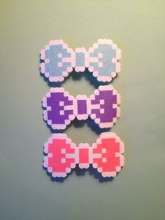 Adorable perler bead hair clips. Maybe a fun DIY?