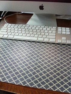 DIY desk pad, my version I used scrapbooking paper and quilter's plastic template. Template comes in multiple sizes. Mine is 12x18, perfect size for under my keyboard/fits 12x12 scrapbooking paper perfectly.