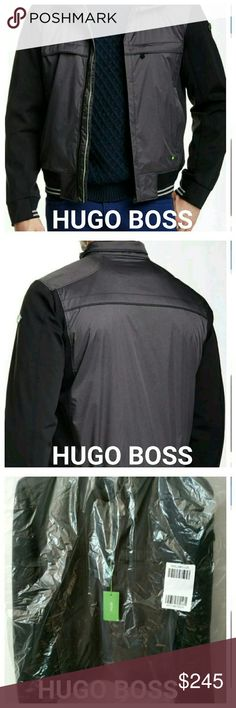 """New Hugo boss jaden jacket golf career L XL XXL Brand new w tags  - Stand-up collar - Long contrast sleeves - Covered front zip closure - 1 chest zip pocket - 2 front zip pockets - 2 interior pockets - Stretch ribbing at cuffs and hem - Lined - Approx. 26"""" length - Imported  Fiber Content:  Shell: 56% polyester, 44% polyamide Sleeves: 84% polyamide, 16% elastane Back Panel: 100% polyamide Lining: 100% polyester  Care:  Wash cold or dry clean Hugo Boss Jackets & Coats"""