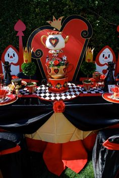Queen of Hearts table design by : Wonderland Party Props.