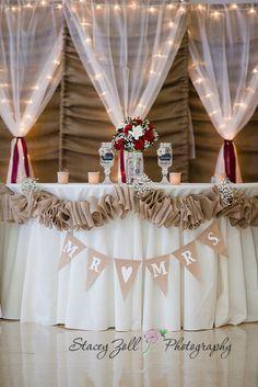 Reception decorations / Red roses / burlap & lights backdrop / curtains / Red roses / Banner / mason jar wine glasses / Elegant Wedding DIY | Kansas Wedding Photographer | Stacey Zoll Photography Manhattan, KS | staceyzphotography.com