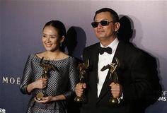 "Hong Kong director Wong Kar-wai, right, and Chinese actress Zhang Ziyi pose after winning the Best Director, the Best Movie and the Best Actress for their movie ""The Grandmaster,"" of the Asian Film Awards in Macau Thursday, March 27, 2014. (AP Photo/Kin Cheung) ▼28Mar2014AP|'Grandmaster' earns top honor at Asian Film Awards http://bigstory.ap.org/article/grandmaster-earns-top-honor-asian-film-awards"