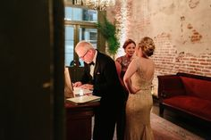 It's always nice to take a moment to enjoy your wedding reception with your parents!  Laura & Bennett! Tate Tullier Photography. Latrobe's On Royal. French Quarter, New Orleans Wedding.