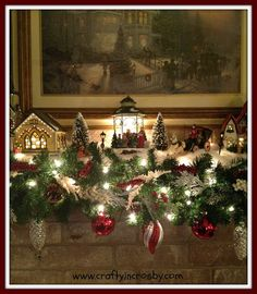 Mom's Christmas Mantel - beautiful handmade garland and snow village on the fireplace mantel.