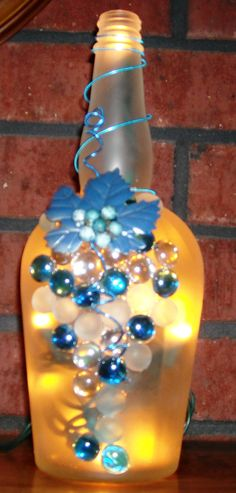 Could do this with candle holders too! Frosted and Blue Glass Wine Liquor Bottle Light with Grapes Design, Bottle Lamp, Night Light, Gift Idea via Etsy Liquor Bottle Lights, Liquor Bottle Crafts, Wine Bottle Art, Lighted Wine Bottles, Wine And Liquor, Diy Bottle, Liquor Bottles, Bottles And Jars, Wine Glass