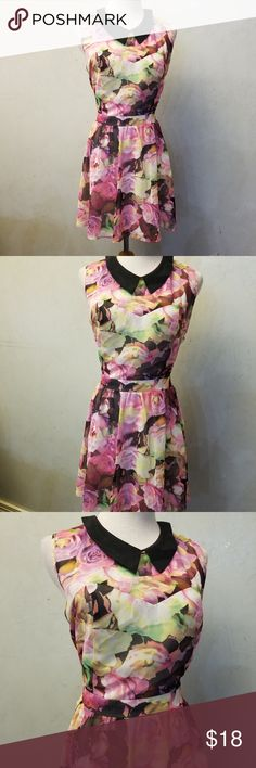 Aeropostale floral dress In perfect condition Aeropostale floral dress with an open back. 100% polyester. 7in from armpit to waistline  17in from the waistline down. 23in from armpit down. Aeropostale Dresses Mini