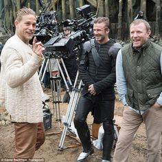 Something funny? David Beckham, 42, treated fans to a behind-the-scenes snap from the set of King Arthur on Instagram on Friday - he is pictured with Charlie Hunnam (left) and director Guy Ritchie (right)