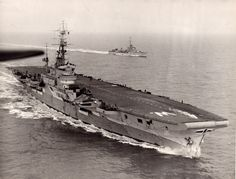 Canadian Navy HMCS WARRIOR  Displacement 13,350 tonnes. Armed with 24-2pdr (6 x IV) guns plus 19x40mm bofor.