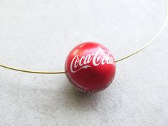 Picture of How to Make a Bottle Cap Bead. Picture of How to Make a Bottle Cap Bead. The post Picture of How to Make a Bottle Cap Bead. appeared first on Craft Ideas. Bottle Cap Jewelry, Bottle Cap Art, Bead Bottle, Bottle Cap Bracelet, Diy Bottle, Bottle Stopper, Bottle Cap Projects, Bottle Cap Crafts, Metal Crafts