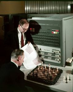 Enjoying a game of chess, the IBM 704 - 1957