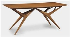 An anigre dining table by Luisa and Ico Parisi. 1950