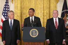 President Barack Obama, John Brennan (R), and former U.S. Sen. Chuck Hagel (R-NB) at the White House on January 7, 2013 in Washington, DC.