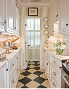 Oooh, talk about charming! I had a kitchen once with grey and white diamond painted wood floors, and I loved it.