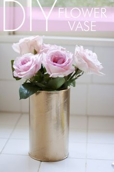 DIY: coffee cans turned into gold flower vases.