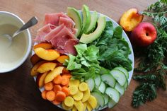 Summer salad with peach, prosciutto and homemade honey/mustard dressing
