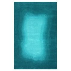 Hand-tufted wool rug with an ombre motif.  Product: RugConstruction Material: 100% WoolColor: TealFeatures: Handmade in India Note: Please be aware that actual colors may vary from those shown on your screen. Accent rugs may also not show the entire pattern that the corresponding area rugs have.