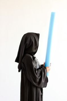 Child wearing a black Star Wars, Dark Side Annakin costume with brown robe. Jawa Costume, Bowling Accessories, Bowling Bags, Adult Crafts, Obi Wan, Black Star, Kids Wear, Star Wars, How To Wear