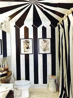 Circus Tent bathroom?  Definitely changing out the artwork on the walls for vintage Circus posters and swapping out the accessories.