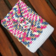 There isn't a pattern with this link but you can easily create a kindle or tablet cover using the Sirdar Beachcomber by either knitting or crocheting. Just chain or cast on your required number of stitches and off you go using your preferred stitch until it reaches the length you need.   Decrease when you need to, add a button and there you have a fabulously quick project!  You can even do this in the round or by creating a long rectangle and sewing up the sides. Kindle Cover, Tablet Cover, Crocheting, Stitches, June, Number, Blanket, Button, Chain