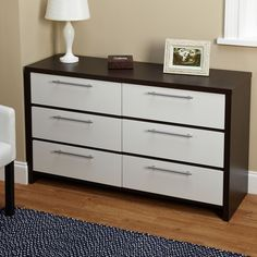 The Two-Tone Six Drawer Chest adds a level of sophistication to any bedroom. With long chrome handles and a two toned European design, the chest is also composed of MDF and paper laminate. #modern #minimalistic #contemporary