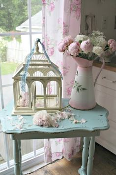 Shabby Chic decor ideas/love the table and birdcage decore'. Maybe go with a different color other than pink for the rest.