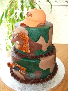 Buttercream hunting camo - My same hunting themed cake but only it's done in buttercream camo this time. Gumpaste hat, deer and gun.
