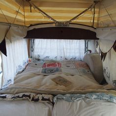 bedding inside a camper van. I could totally road trip it with this, some cash, hiking supplies, a map, and my babe and pup