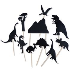 Dinosaur shadow puppets- cutouts of dinosaurs, trees and mountains. Each black plastique cut out is attached to a sturdy wood stick - or make your own.