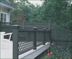 Lattice Railing - Here, a cedar Walpole Lattice Railing is aesthetically balanced by a handcrafted Board and Lattice Fence. Both railing and fence can now be crafted in solid cellular PVC and prefinished with Sherwin Williams vinyl safe paints. Wood Deck Railing, Vinyl Railing, Staircase Railings, Wood Patio, Concrete Patio, Backyard Patio, Outdoor Spaces, Outdoor Living, Outdoor Decor