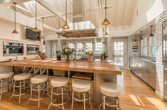 Island - Stovetop in island with thick wood butcher block for seated guests.