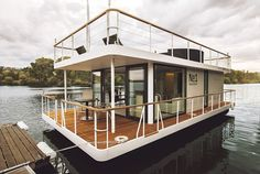 This is the Living Houseboat by Living. It's a modern houseboat with a wrap around deck and an additional rooftop deck. Inside, you'll find a bedroom, living area… Pontoon Houseboat, Houseboat Living, Houseboat Ideas, Pontoon Boat, Floating Architecture, Sustainable Architecture, Residential Architecture, Contemporary Architecture, Water House