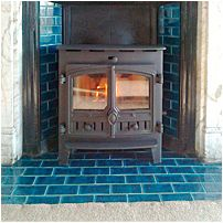 A Hunter inset stove fitted to an original tiled iron surround.